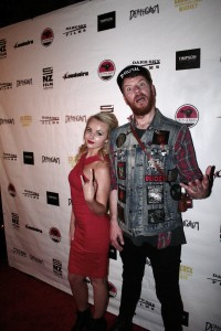 Actress Kimberly Crossman and director Jason Howden walk the red carpet at the Deathgasm premiere.