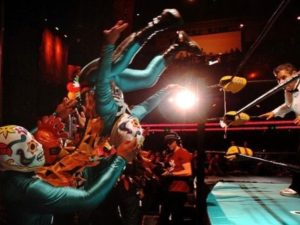 Mexican wrestlers entertain fans at the Lucha Va Voom.